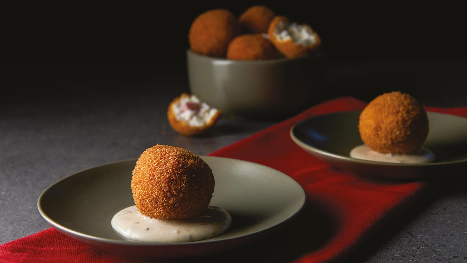 Mortadella And Ricotta Croquette On Cheese And White Truffle Cream